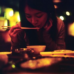 *taste* (hurtingbombz) Tags: 120 6x6 girl night hongkong restaurant udon eating chinese noodles mf 88 kiev provia f28 80mm arsat 400x pushedtwostops