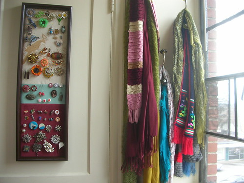 A wired frame hung to display brooches, via Flickr: bliss24.