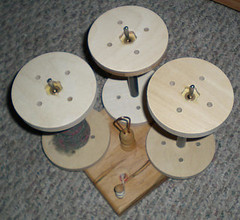 SpinOlution bobbins on Kate - top view
