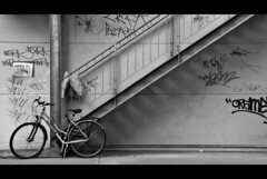 Stairs to Bike (edouardv66) Tags: bw bike wall stairs switzerland blackwhite nikon suisse geneva mountainbike nb jacket d200 mur genve 18200 vr vlo noirblanc escaliers graffities