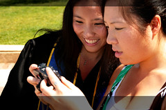 0614_012 Looking at pics_OpCrop (Eutychus22) Tags: graduation ucla metaphotography