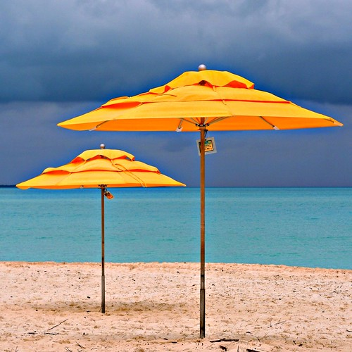 rule of fourths! yellow umbrellas and the impending storm
