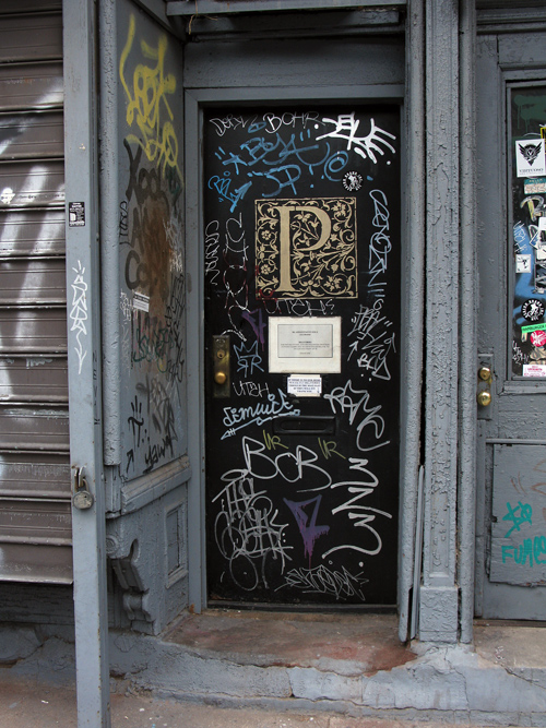 an entrance with graffiti on 4th Street, Manhattan, NYC