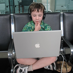 Airport (.michael.newman.) Tags: boy dog television computer notebook kid airport mac waiting wallet laptop headphones chin killingtime crosslegged macbook