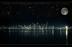 Dreams of the Emerald City of Seattle (:: Igor Borisenko Photography ::) Tags: seattle longexposure original white lake black beach water night reflections stars point lights bay washington high amazing nikon mood glow moody cityscape skyscrapers quality smooth creative surreal nikond50 best fullmoon galaxy sound alki wa romantic glowing dslr popular toned westcoast emeraldcity allrightsreserved silky cs3 phenomenal aplusphoto digitalmattepainting ultimateshot igorb81 infinestyle alkipointbeach igorborisenkophotography niksilverefexpro dramaticdark
