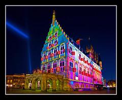 Colorful Gouda city hall (Focusje (tammostrijker.photodeck.com)) Tags: christmas light holland art netherlands night back cityhall projection 2008 stadhuis gouda warrener patricewarrener polychromatic goudabijkunstlicht chromolithe