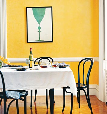 Yellow dining room + blue poster: Domino