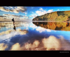 Standing in the clouds (Mark Emirali) Tags: ocean blue sea newzealand cloud seascape colour reflection beach nature canon landscape wideangle auckland nz westcoast aotearoa 1022mm hdr bethells copyrighted oneils pleasedonotusewithoutmypermission maloe4 meandmychickenlegs maloephoto maloephotography markemirali markemiraliphotography
