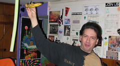 20081211 - Chris H visits - IMG_0033 - Clint, banana...OF DOOM - (by Chris) (Rev. Xanatos Satanicos Bombasticos (ClintJCL)) Tags: food kitchen alexandria virginia holding comedy cabinet visit banana clint visiting 2008 hangingout cabinets clintandcarolynshouse chrishannersvisit 200812 20081211 camerapersonchrishanners chrishannersvisit20081211 hangingout20081211