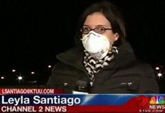 poorly fitted respirator on TV news person