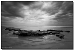 A Storm is Brewing (Fraggle Red) Tags: ocean longexposure bw storm beach water rock clouds sand afternoon florida lowtide atlanticocean canonef1740mmf4lusm marineland coquina washingtonoaksstatepark nd110 10stopnd bwnd110 flaglerco adobelightroom3