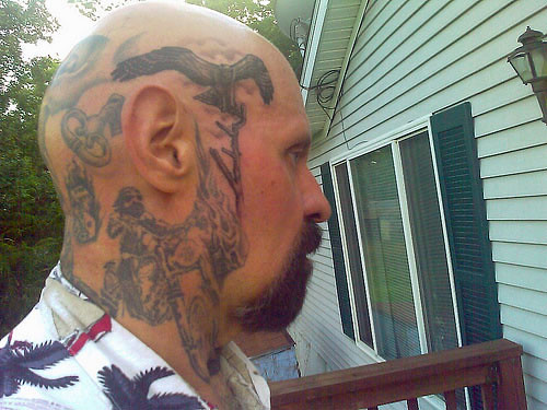 An eagle and branch tattoo on the right side of my head.