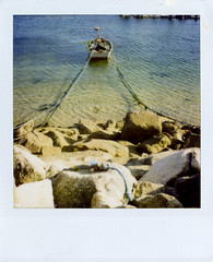 amarrada (shawara) Tags: sea film polaroid puerto sx70 boat mar barca galicia 600 instantanea instantphoto cangas ndfilter instantfilm