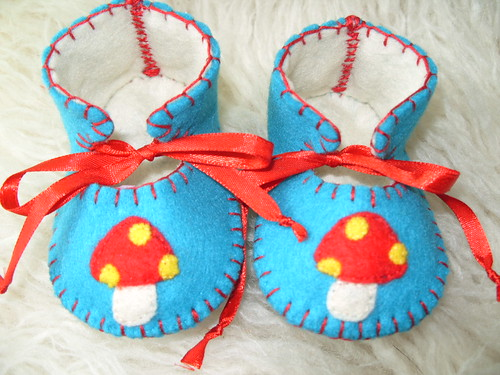 teal and cream baby booties with cute mushroom motifs-hand-stitched by Funky Shapes