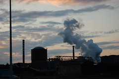 Smoke melting with clouds (Sundust_L) Tags: sunset sky port tramonto sonnenuntergang smoke porto cielo  hafen industrie   chimneys contrejour industries  rauch fumo ciminiere  coucherdusoleil piombino    naturallyartificial industrien contruluz