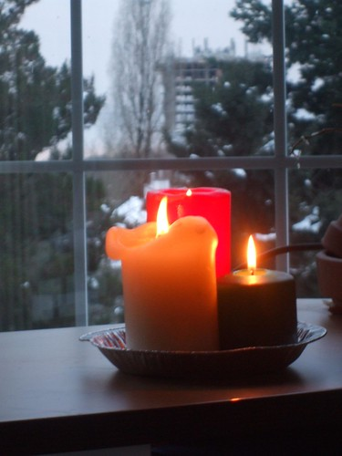 Three candles burning in the window