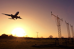 Commercial airplane landing (Greg Bajor) Tags: plane sunrise airplane heathrow aircraft flight jet aeroplane boeing gregory approach 777 bajor birdlikeimages gregbajor