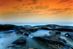 Sea Waterfall 2 (A.alFoudry) Tags: ocean sky seascape motion fall beach water rock speed sunrise canon landscape eos high rocks slow gulf falls full filter arab shore frame slowshutter shutter land 5d kuwait usm arabian fullframe scape effect 2009 tobacco ef 1740mm canonef1740mmf4lusm kuwaiti arabiangulf q8 cokinfilter slowshutterspeed newday abdullah  cokin  f4l canoneos5d  kuw q80  xnuzha alfoudry  abdullahalfoudry foudryphotocom
