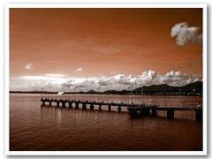 the future is bright the future is orange (SaDDuL) Tags: sea sky orange photoshop pier cs3 tacloban taclobancity