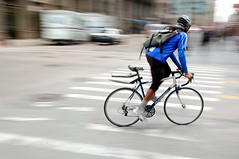 Accelerate! (jeremyhughes) Tags: street city blue chicago blur bike bicycle speed cycling nikon cyclist raleigh messenger nikkor panning bikemessenger citystreet accelerate bluejacket d40 bluebike 18200mmf3556gvr accelaration nikond40
