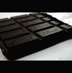 Bar Of Chocolates (M ï M ï) Tags: food brown white black bar focus chocolates delicious eat cacao yummmmmy
