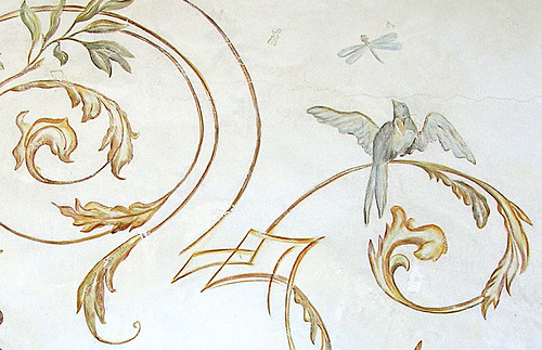 Detail of bird catching Dragonfly on exterior mural