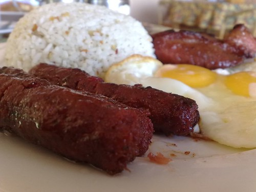 Clockwise from bottom left: longganiza, sinangag, pork tocino, and eggs