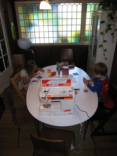 The kids doing crafts at the diningtable