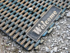 Worn old welcome mat