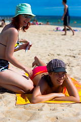 Sunscreen Sisters (yeshayden) Tags: ocean girls sea summer sun beach hat sunglasses sisters colorful skin sunny australia bluesky bikini shorts colourful swimsuit sunscreen unikorn manimeet princessunikorn