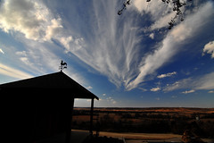 Convergent Spiraling Clouds (mbryan777) Tags: blue sky oklahoma clouds convergent nikon tokina weathervane 12mm 1224mm twisting d300 spiraling mywinners mbryan777 michaelbryanphotography