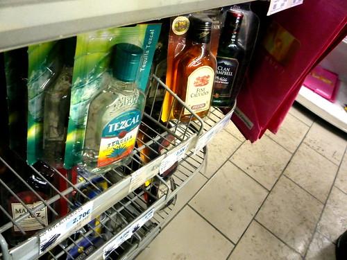 bottles scotch gin whiskey sale blister packs sales racks booze in blister packs