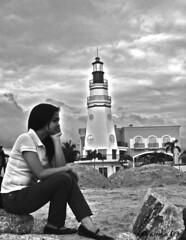 Black Contemplation (ERIC OEBANDA) Tags: woman lighthouse girl female philippines pinay pinoy ih oebanda