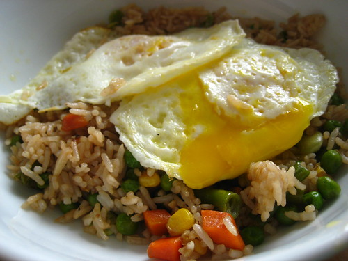 fried eggs over fried rice