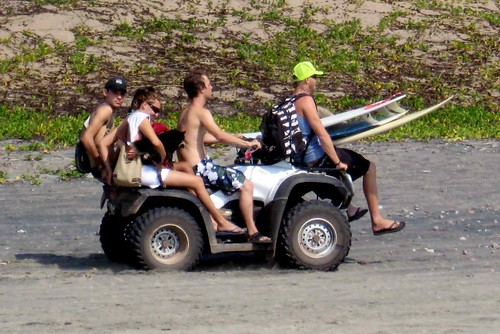 Nate rides away on moto with surfers