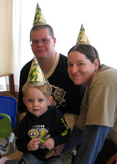 happy family in birthday hats