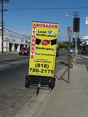 Ad sign as seen in traffic: Loan Modification ...