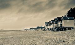Wells next the Sea (John Venier) Tags: people beach wet stairs dark sand cloudy silhouettes footprints stormy beachhuts wellsnextthesea