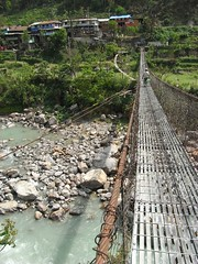 Bridge over to village in the Annapurna circuit