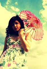 catchin the wind (Shery Han) Tags: flowers portrait sky woman flower girl clouds umbrella vintage hair outdoors model pattern dress wind parasol crossprocessing