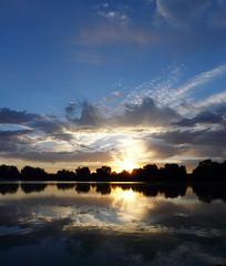 Panorama 210 (jimbohoo2003) Tags: sunset panorama clouds reflections colorado sunsets denver washingtonpark panasonicdmcfz18