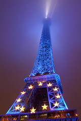 Blue Eiffel Tower in fog