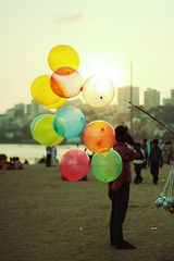 balloons_01 (zedvox) Tags: street light sunset red india inspiration abstract color art love beach colors night canon balloons landscape photography 50mm design colorful graphic random bokeh indian balloon experiment style objects nostalgia observe bombay mumbai 2008 bandra chowpatty 50mmf18 ef50mmf18 tyagi aashim 40d canon40d
