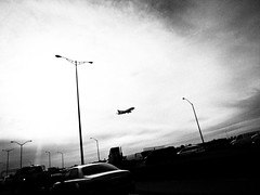 departure (liver1223) Tags: street 2 sky blackandwhite bw toronto canada car plane photo interesting highway shot snap aeroplane explore gr ricoh grd interesingness explored blackwhitephotos grdigital2