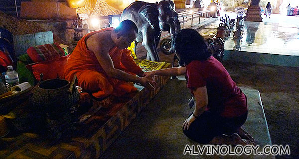 Nicole getting blessed by a Thai monk