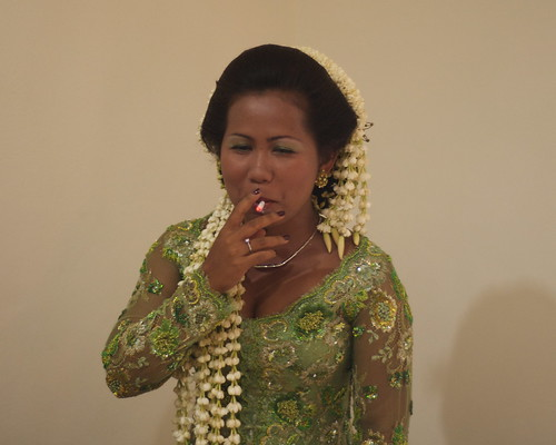 Traditional Javanese Bride with cigarette There were lots of flower petals