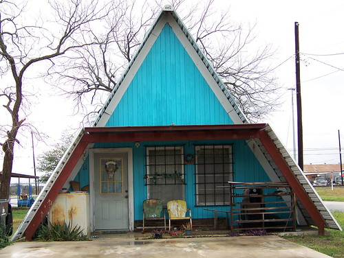 Front view of blue a-frame home