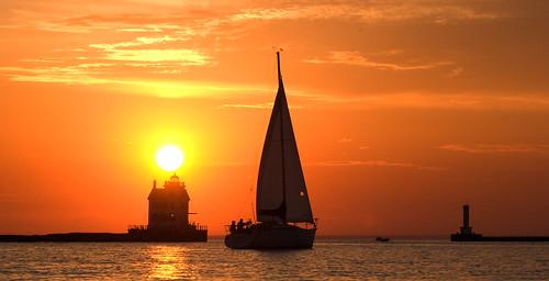 sunset ohio sun lighthouse sailboat lakeerie horizon greatlakes lorain