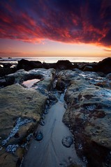 Intertidal Zone (Nick Carver Photography) Tags: ocean california ca travel autumn sunset sea usa cloud fall beach nature water rock vertical clouds landscape outdoors coast landscapes us sand rocks pacific tide nick carver southerncalifornia orangecounty westcoast tidepools tidepool tides lagunabeach rockformation nickcarver ncpfineartprint