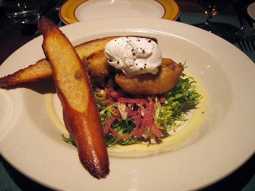 Frisee salad with poached egg and duck liver
